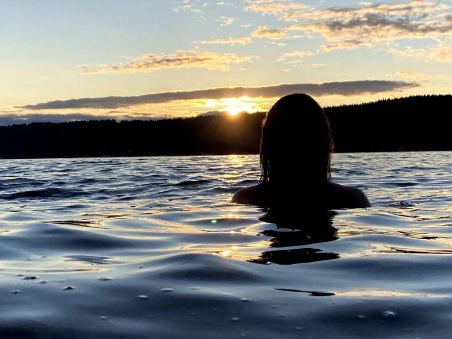 Junior Christina Harisov, enjoys some peaceful time in the lake at Twanoh state park in Union, Washington.