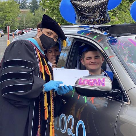 Superintendent, Dr. Katrise Perera celebrates the class of 2020 through attending the drive through graduation.