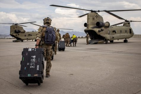U.S. and other coalition soldiers boarding helicopters to leave Bagram Air Field in May.